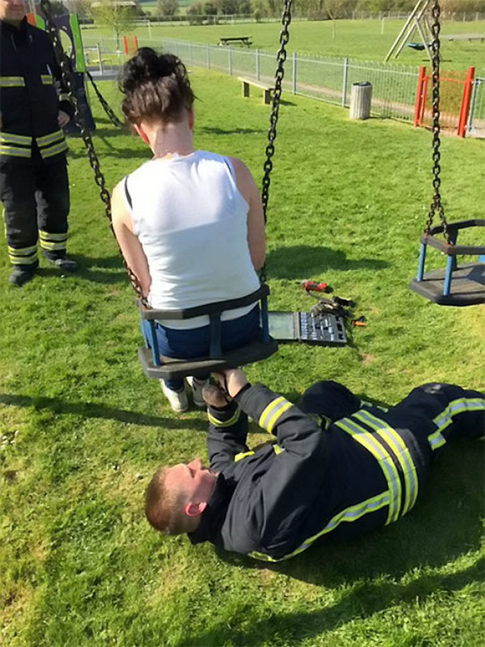 Firefighter Rescuing A Teenager After She Got Stuck In A Baby Swing